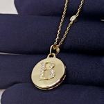 Relicário em Ouro 18k Redondo cravejado com Diamantes