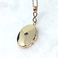Relicário em Ouro 18k 750 com Diamante