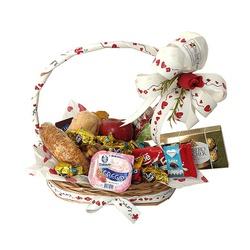 Cesta de café com pães, frutas e chocolates