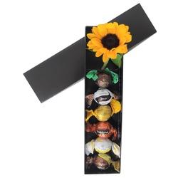 Caixa preta com girassol e seis trufas da cacau show