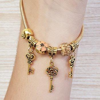 Pulseira Pandora Chaves Dourado Velho Champanhe
