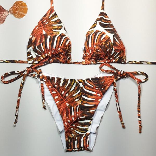 Biquíni Monstera Laranja | www.useamazona.com.br | Produzido pela Amazona Beachwear | Biquini Estampado Costela de Adão | Cor: Estampado. Tecido: Supermicrofibra, com proteção UV, tratamento com aloe vera. Modelo: Top cortininha com bojo removível incluso