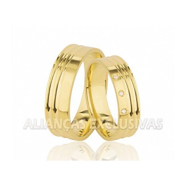 par de alianças de casamento em ouro 18k com pedras de diamantes