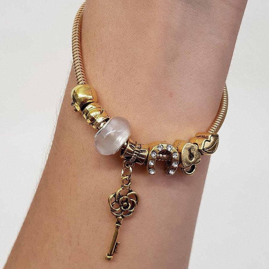 Pulseira Pandora Chave Dourado Branco